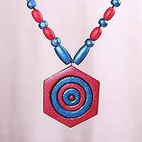 Coconut shell pendant necklace, 'Blissful Essence' - Red and Blue Hexagon Coconut Shell Pendant Necklace