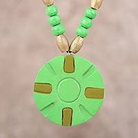 Coconut shell pendant necklace, 'Green Surrounds' - Green Ivory Wood and Coconut Shell Round Pendant Necklace
