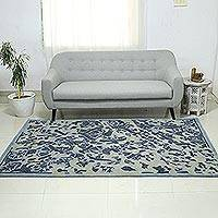 Wool area rug, 'Blue Majestic Garden' (5x8) - Blue and Grey Floral Wool Area Rug (5x8) from India