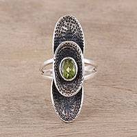 Peridot cocktail ring, 'Oval Fantasy' - Sterling Silver Oval Faceted Green Peridot Cocktail Ring