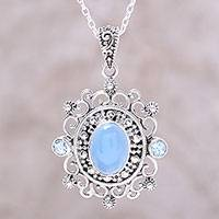 Blue topaz and chalcedony pendant necklace, 'Glowing Heaven' - Blue Topaz and Chalcedony Pendant Necklace from India