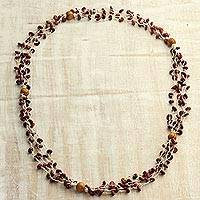 Wood torsade necklace, 'Burgundy Pebbles' - Burgundy Haldu Wood Woven Beaded Long Torsade Necklace