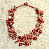 Wood torsade necklace, 'Magical Sunset' - Orange Haldu Wood Beaded Multi-Strand Torsade Necklace