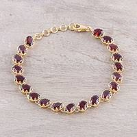 Gold plated garnet tennis-style bracelet, 'Regal Garland' - Gold Plated 20-Carat Garnet Tennis-Style Bracelet from India