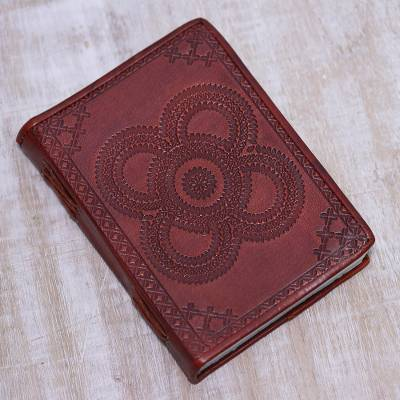 Leather journal, 'Floral Echoes' - Handcrafted Flower Circles Embossed Dark Red Leather Journal