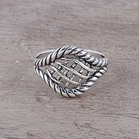 Sterling silver cocktail ring, 'Intertwined Elegance' - Woven Motif Sterling Silver Cocktail Ring from India