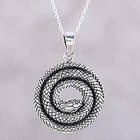 Sterling silver pendant necklace, 'Sleeping Serpent' - Coiled Snake Sterling Silver Pendant Necklace from India