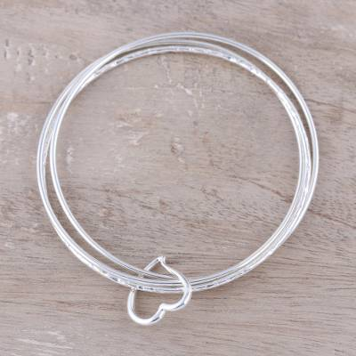 Sterling silver bangle bracelet, 'Connected by Love' - Heart Shape Sterling Silver Bangle Bracelet from India