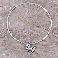 Sterling silver bangle bracelet, 'Content Heart' - Sterling Silver Heart Charm Bangle Bracelet from India