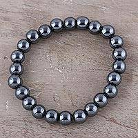 Hematite beaded stretch bracelet, 'Magical Evening' - Handmade Hematite Elastic Beaded Bracelet from India