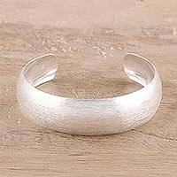 Sterling silver cuff bracelet, 'Glimmering Charm' - Brushed-Satin Sterling Silver Cuff Bracelet from India