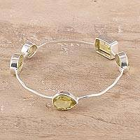 Quartz bangle bracelet, 'Thoughtful' - Yellow Quartz Bangle Bracelet from India