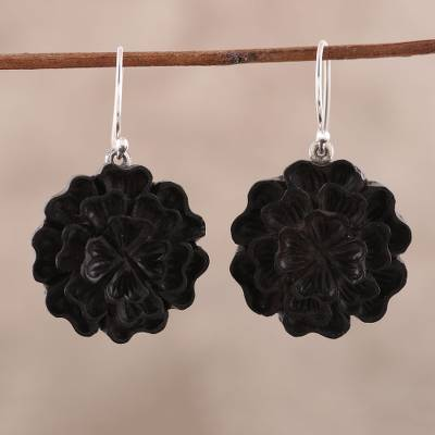 Ebony wood dangle earrings, 'Marigold Charm' - Hand-Carved Floral Ebony Wood Dangle Earrings from India