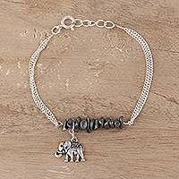 Sterling silver and howlite bracelet, 'Dangling Elephant' - Sterling Silver and Hematite Elephant Bracelet from India