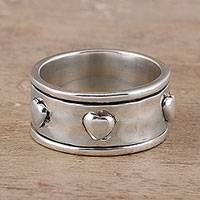 Sterling silver spinner ring, 'Mesmerizing Hearts' - Heart Motif Sterling Silver Spinner Ring from India
