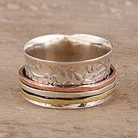 Sterling silver spinner ring, 'Floral Rush' - Floral Sterling Silver Spinner Ring from India