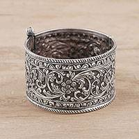 Sterling silver bangle bracelet, 'Rajasthan Classic' - Floral Sterling Silver Bangle Bracelet from India