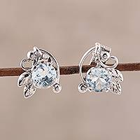 Rhodium plated blue topaz stud earrings, 'Leafy Glisten' - Rhodium Plated Blue Topaz Stud Earrings from India
