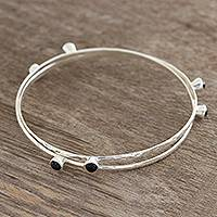 Onyx bangle bracelets, 'Magical Connection' (pair) - Onyx Bangle Bracelets from India (Pair)