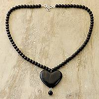 Ebony wood beaded pendant necklace, 'Love in the Heart' - Heart-Shaped Ebony Wood Beaded Pendant Necklace from India