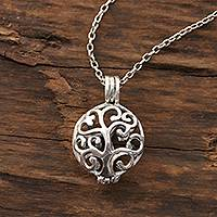 Sterling silver locket necklace, 'Happy Curl' - Curl Pattern Sterling Silver Locket Necklace from India