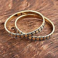 Brass bangle bracelets, 'Delightful Dots' (pair) - Dot Pattern Brass Bangle Bracelets from India (Pair)