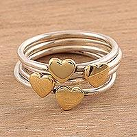 Sterling silver band rings, 'Heart Royalty' (set of 4) - Sterling Silver and Brass Heart Band Rings from India