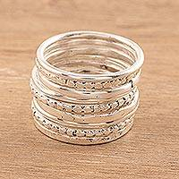 Sterling silver band rings, 'Friendship Patterns' (set of 9) - Sterling Silver Band Rings Crafted in India (Set of 9)