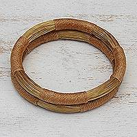Golden grass bangle bracelets, 'Jalapão Equilibrium' (pair) - Pair of Handcrafted Golden Grass Bangle Bracelets