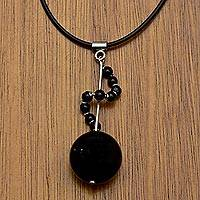 Agate pendant necklace, 'Moving On' - Black Agate and 925 Silver Pendant on Black Rubber Necklace