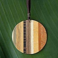 Wood pendant necklace, 'Circle Traveler' - Circular Wood Pendant Necklace from Brazil