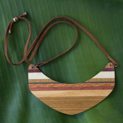 Wood pendant necklace, 'Striped Boomerang' - Boomerang Shaped Wood Pendant Necklace from Brazil