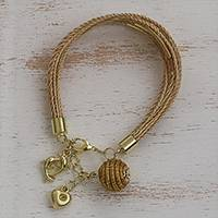 Gold accented golden grass charm bracelet, 'Romantic Dolphins' - Gold Accent Golden Grass Dolphin Charm Bracelet from Brazil