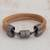 Leather wristband bracelet, 'Forged' - Double Band Light Brown Leather Unisex Wristband Bracelet thumbail