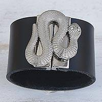 Leather wristband bracelet, 'Serpent Gatekeeper in Black' - Snake-Themed Black Leather Wristband Bracelet from Brazil