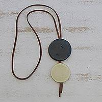 Glass and leather pendant necklace, 'Blue Eclipse' - Blue Glass and Leather Pendant Necklace from Brazil