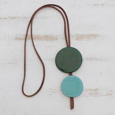 Glass and leather pendant necklace, 'Green Eclipse' - Green Glass and Leather Pendant Necklace from Brazil