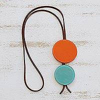 Glass and leather pendant necklace, 'Orange Eclipse' - Orange and Blue Glass and Leather Pendant Necklace