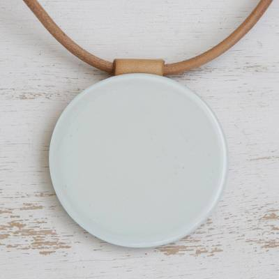 Fused glass pendant necklace, 'Rising Moon' - White Fused Glass Disc Pendant Brown Leather Cord Necklace