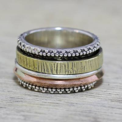 Sterling silver meditation spinner ring, 'Textured Beauty' - Sterling Silver Copper and Brass Textured Spinner Ring