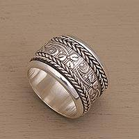 Sterling silver spinner ring, 'Floral Focus' - Wide Sterling Silver Spinner Ring with Floral Motifs