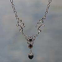Onyx and garnet Y necklace,