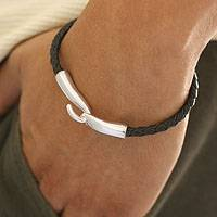 Men's leather bracelet, 'Metropolis' - Men's Collectible Braided Leather and Silver Bracelet