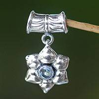 Blue topaz pendant, 'Narcissus of December' - Floral Sterling Silver and Blue Topaz Pendant