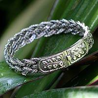 Sterling silver braided bracelet, 'Symmetry' - Fair Trade Sterling Silver Wristband Bracelet
