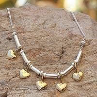 Gold plated bracelet, 'Dancing Hearts' - Heart Shaped Sterling Silver Gold Accent Charm Bracelet