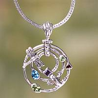 Peridot and blue topaz pendant necklace, 'Fantasy Garden' (Indonesia)