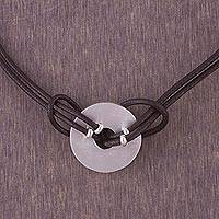 Sterling silver and leather pendant necklace, 'Intrepid' - Sterling silver and leather pendant necklace