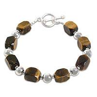 Tiger's eye beaded bracelet, 'Attraction' - Tiger's eye beaded bracelet