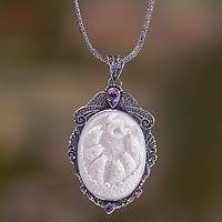 Bone and amethyst pendant necklace, 'Seven Fish' - Amethyst Necklace with Carved Bone Medallion